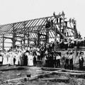 795px-Barn_raising_in_Lansing