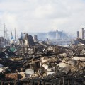 NEW YORK - October 31 Homes sit smoldering after Hurricane Sandy in the Far Rockaway area . Over 50 homes were reportedly destroyed in a fire during the storm on October 30; 2012